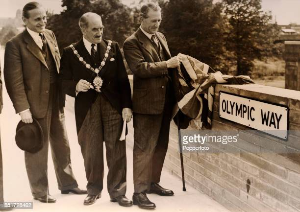 Lord Burghley Olympic Games chairman the Mayor of Wembley and the Minister for Transport Alfred Barnes open the new road to Wembley Stadium prior to...