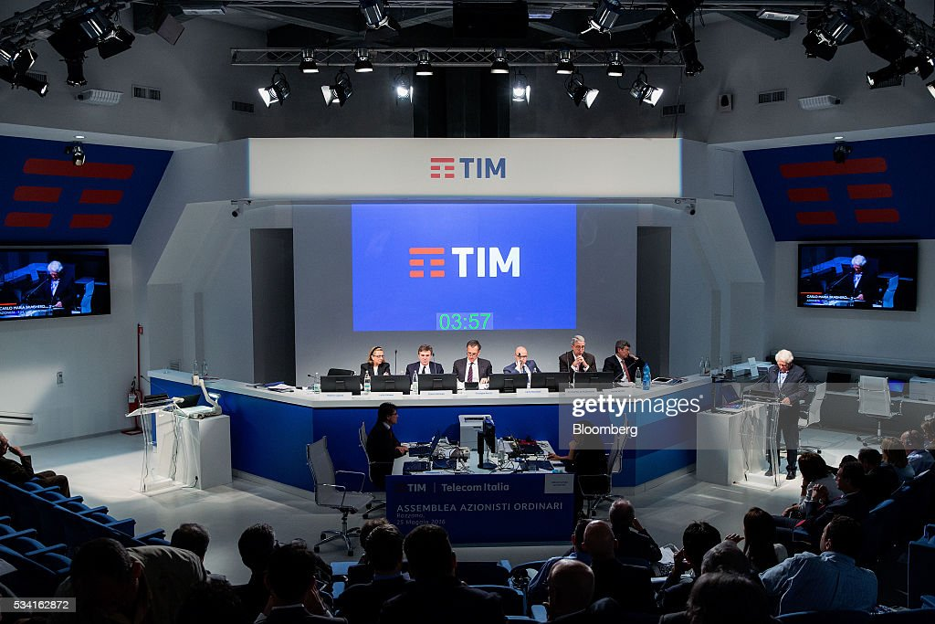 Left to right, Lucia Calvosa, board member of Telecom Italia SpA, Flavio Cattaneo, chief executive officer of Telecom Italia SpA, Giuseppe Recchi, chairman of Telecom Italia SpA, Carlo Marchetti, notary of Telecom Italia SpA, Arnaud De Puyfontaine, chief executive officer of Vivendi SA, and Davide Benello, board member of Telecom Italia SpA, sit on a panel during the company's annual general meeting (AGM) at their headquarters in Rozzano, near Milan, Italy, on Wednesday May 25, 2016. Telecom Italia named Cattaneo as CEO in March, turning to a media industry veteran to implement a turnaround. Photographer: Alessia Pierdomenico/Bloomberg via Getty Images