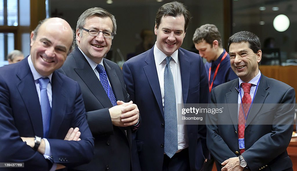 Left to right Luis de Guindos Spain's economy minister Steven Vanackere Belgium's finance minister George Osborne UK chancellor of the exchequer and...