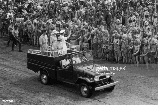 Mark Phillips Princess Anne Queen Elizabeth II and Prince Philip waving to Asaro Mudmen from a jeep during a royal tour of Papua New Guinea February...
