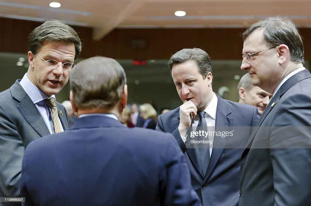 Left to right, <a gi-track='captionPersonalityLinkClicked' href=/galleries/search?phrase=Mark+Rutte&family=editorial&specificpeople=4509362 ng-click='$event.stopPropagation()'>Mark Rutte</a>, the Netherlands's prime minister, speaks with <a gi-track='captionPersonalityLinkClicked' href=/galleries/search?phrase=Silvio+Berlusconi&family=editorial&specificpeople=201842 ng-click='$event.stopPropagation()'>Silvio Berlusconi</a>, Italy's prime minister, <a gi-track='captionPersonalityLinkClicked' href=/galleries/search?phrase=David+Cameron+-+Pol%C3%ADtico&family=editorial&specificpeople=227076 ng-click='$event.stopPropagation()'>David Cameron</a>, the U.K.'s prime minister, and <a gi-track='captionPersonalityLinkClicked' href=/galleries/search?phrase=Petr+Necas&family=editorial&specificpeople=3014277 ng-click='$event.stopPropagation()'>Petr Necas</a>, the Czech Republic's prime minister, during the European Union (EU) summit at the European Council headquarters in Brussels, Belgium, on Friday, March 25, 2011. European Union leaders cut the startup capital for the future euro emergency aid mechanism after German demands to make smaller upfront payments stoked fresh concerns about Europe's effort to quell the debt crisis. Photographer: Jock Fistick/Bloomberg via Getty Images