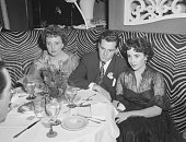 Mrs Max Saxon sitting with Conrad 'Nicky' Hilton Jr and actress Elizabeth Taylor at El Morocco nightclub 154 East 54th Street New York City