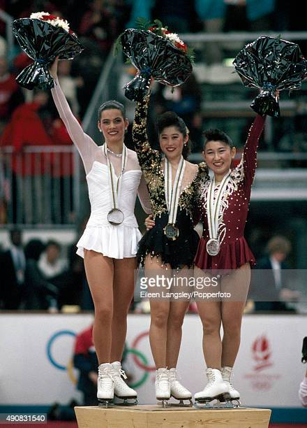 Nancy Kerrigan of the United States Kristi Yamaguchi of the United States and Midori Ito of Japan medallists in the ladies figure skating event...