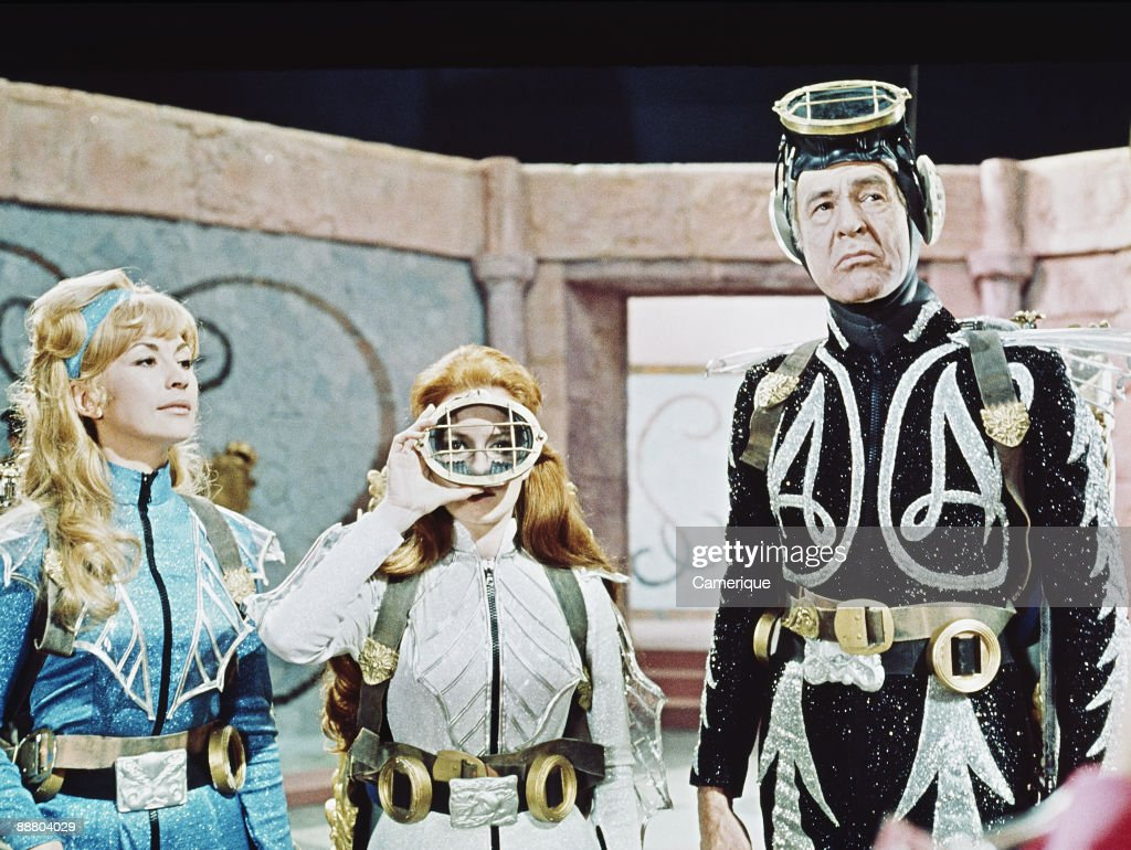 Nanette Newman, Luciana Paluzzi and Robert Ryan (1909 - 1973) in a scene from James Hill's science fiction film 'Captain Nemo and the Underwater City', 1969.
