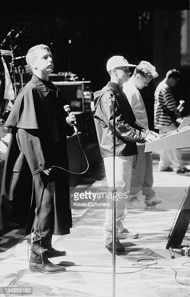 Neil Tennant and Chris Lowe of the Pet Shop Boys performing on stage with Bernard Sumner and Johnny Marr of Electronic at the Dodgers Stadium Los...