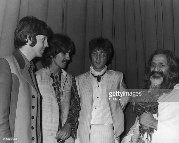 Paul McCartney George Harrison and John Lennon of the Beatles backstage with the Maharishi Mahesh Yogi after he gave a lecture on transcendental...