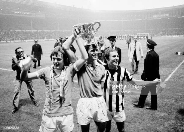 Left to right Peter Barnes Dave Watson and Dennis Tueart of Mancester City with the League Cup trophy after their 21 victory over Newcastle United at...