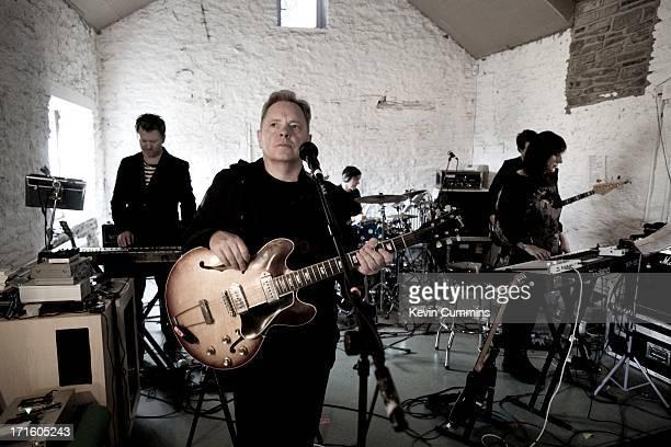 Phil Cunningham Bernard Sumner Stephen Morris Tom Chapman and Gillian Gilbert of New Order in the band's rehearsal studio UK 22nd September 2011...