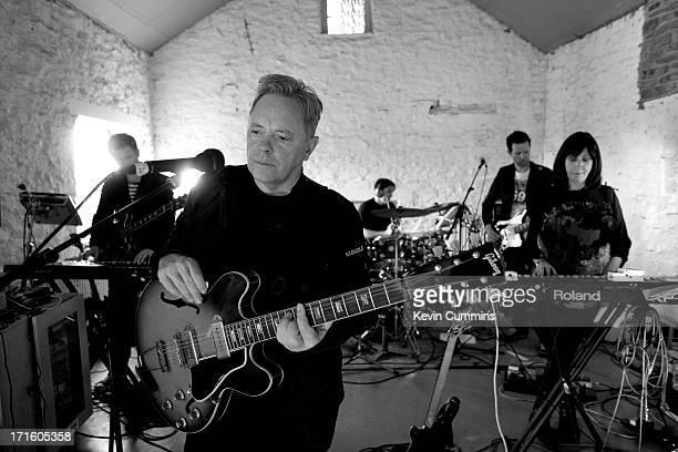Phil Cunningham Bernard Sumner Stephen Morris Tom Chapman and Gillian Gilbert of New Order in the band's rehearsal studio UK 22nd September 2011