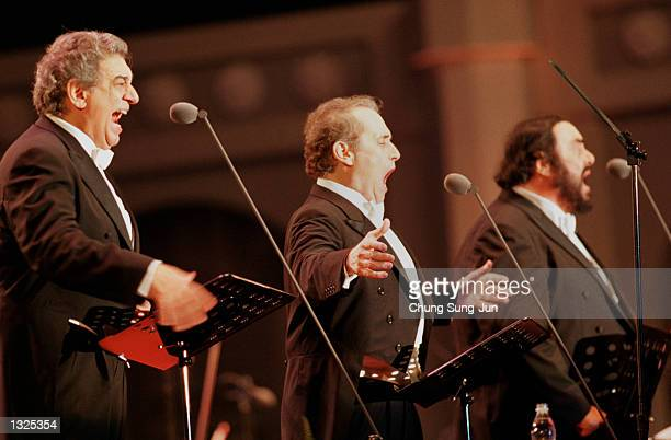 Left to right Placido Domingo Jose Carreras and Luciano Pavarotti sing during the Three Tenors'' concert June 22 2001 at Chamsil Olympic stadium in...
