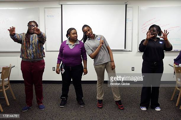 Left to right Porsha Olayiwola Codman Academy team coach and students Latasha Snider Ogechi Okwologu and Ymahri Brown during a group practice for the...