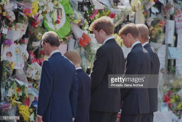 Prince Charles Prince Harry Earl Spencer Prince William and Prince Philip viewing floral tributes outside Westminster Abbey at the funeral of Diana...