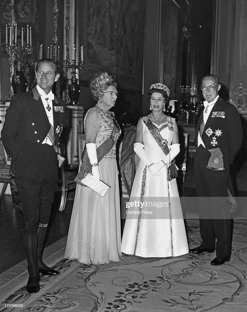 Prince Philip Queen Juliana of the Netherlands Queen Elizabeth and Prince Bernhard of the Netherlands before a state banquet at Windsor Castle 11th...