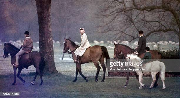 Princess Anne riding High Jinks Queen Elizabeth II riding Sultan and a groom leading Lord Linley riding Willy of Watersmeet in Windsor Park on 1st...