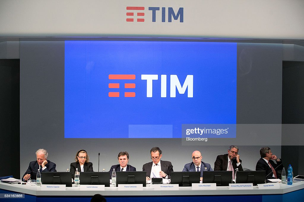 Left to right, Robeto Capone, acting auditor of Telecom Italia SpA, Lucia Calvosa, board member of Telecom Italia SpA, Flavio Cattaneo, chief executive officer of Telecom Italia SpA, Giuseppe Recchi, chairman of Telecom Italia SpA, Carlo Marchetti, notary of Telecom Italia SpA, Arnaud De Puyfontaine, chief executive officer of Vivendi SA, and Davide Benello, board member of Telecom Italia SpA, sit on a panel during the company's annual general meeting (AGM) at their headquarters in Rozzano, near Milan, Italy, on Wednesday May 25, 2016. Telecom Italia named Cattaneo as CEO in March, turning to a media industry veteran to implement a turnaround. Photographer: Alessia Pierdomenico/Bloomberg via Getty Images