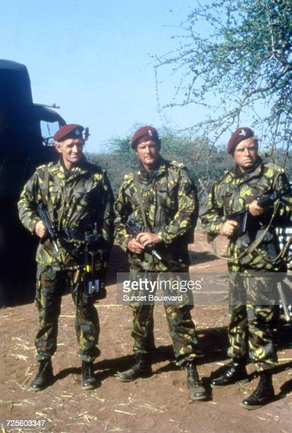 Roger Moore Richard Harris and Hardy Krüger in 'The Wild Geese' directed by Andrew V McLaglen South Africa 1978
