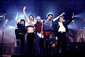 Ron Wood Mick Jagger Charlie Watts Keith Richards and Bill Wyman of the Rolling Stones wave to the crowd at the Historic Atlantic City Convention...