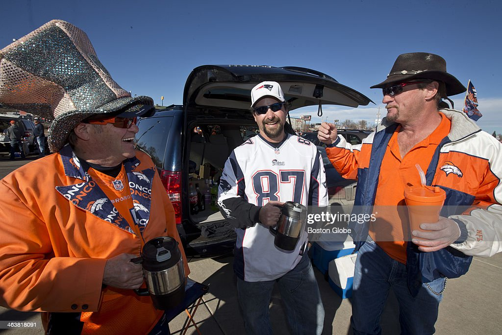 Left to right Rusty Strohmayer Kip McCormick and Eric Creede tailgate before the New England Patriots play the Denver Broncos in the AFC Championship...