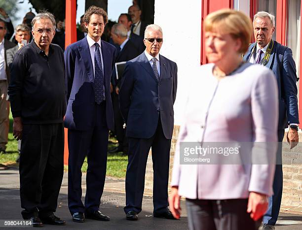 Left to right Sergio Marchionne chief executive officer of Fiat Chrysler Automobiles NV John Elkann chairman of Fiat Chrysler Automobiles NV Piero...