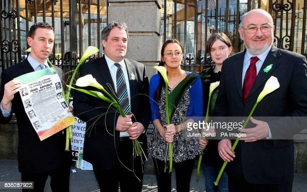 Left to right Shaun Tracey Aengus O'Snodaigh TD Oonagh O'Reilly Aine Downes and Caoimhin O'Caolain TD holding lilies and the 1916 Proclamation as...