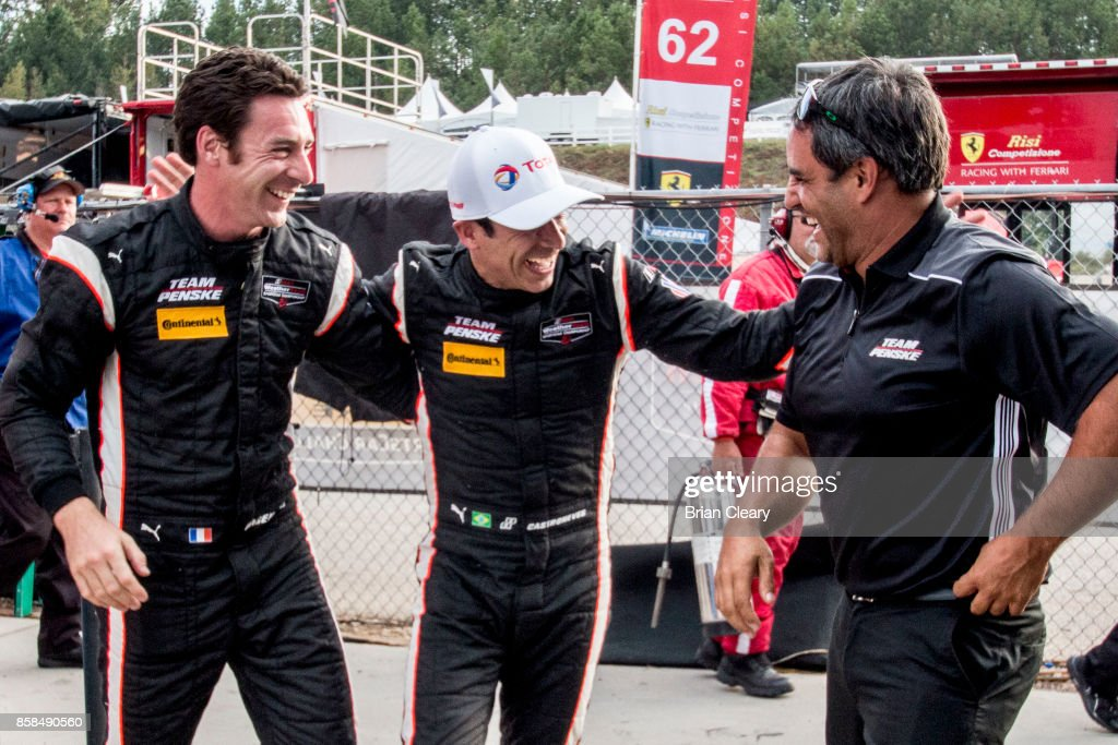 Left to right, Simon Pagenaud, of France, Helio Castroneves, of Brazil, and Juan Pablo Montoya, of Colombia, celebrate after winning the pole position for the Motul Petit Le Mans at Road Atlanta on October 6, 2017 in Braselton, Georgia.