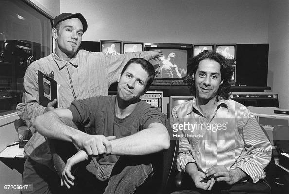singer and songwriter Michael Stipe of American rock group REM director Jim McKay and editor Walter Schlomann in an editing suite during...