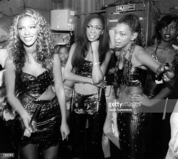 Left to right Singer Beyonce Knowles and Michelle Williams Kelly Rowland of RB sensation Destiny's Child await backstage before going onstage to...