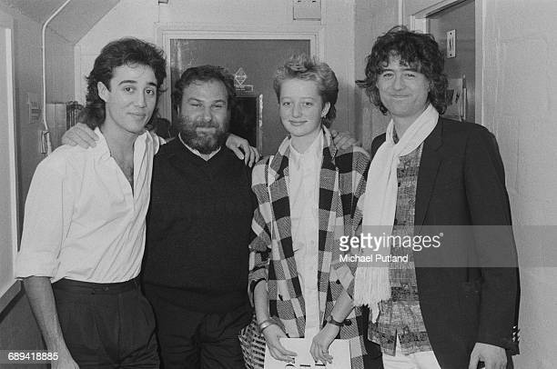 singersongwriter Andrew Ridgeley of Wham concert promoter Harvey Goldsmith Scarlet Page and her father guitarist Jimmy Page backstage at a Wham...