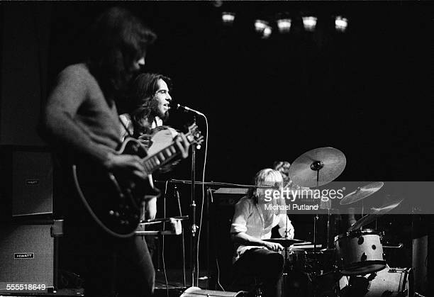 Steve Hackett Peter Gabriel and Phil Collins of English progressive rock group Genesis perform on stage London 1971