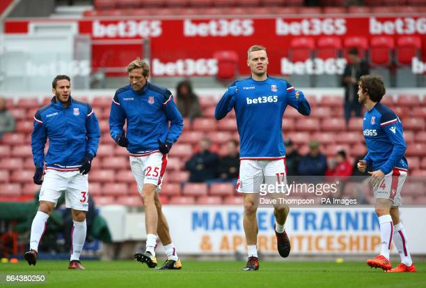Left to right Stoke City's Ramadan Sobhi Peter Crouch Ryan Shawcross and Joe Allen before the Premier League match at the bet365 Stadium StokeonTrent