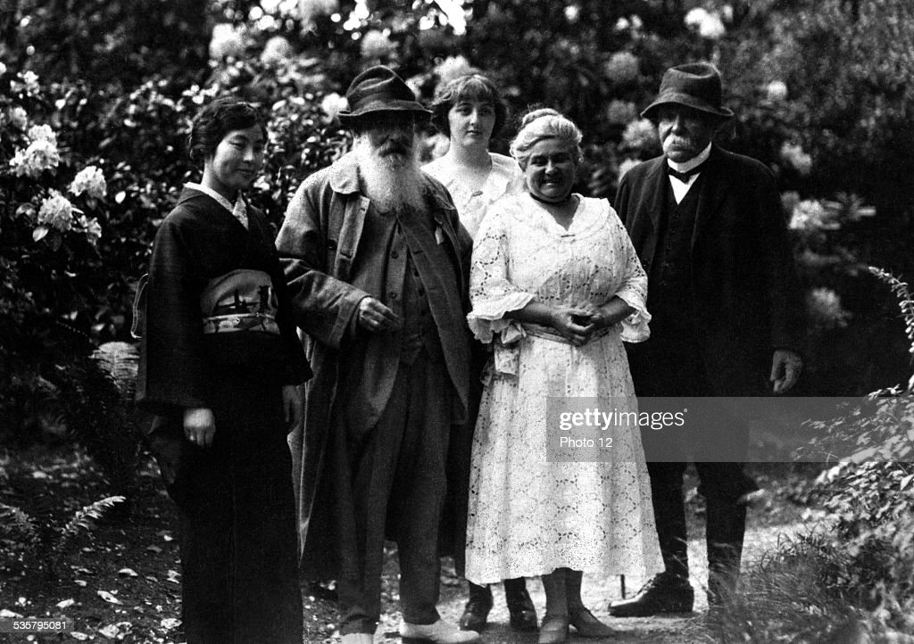 Takeko Kuroki, French painter Claude Monet (1840 - 1926), his niece Alice (Lilly) Butler (1894 - 1949), his step daughter, French painter Blanche Hoschede-Monet (1865 - 1947), and French statesman Georges Clemenceau (1841 - 1929), by the water garden at Monet's home in Giverny, Eure, France, 1921. Takeko Kuroki and her husband, Sanji Kuroki, spent three years in France collecting artworks on behalf of Takeko Kuroki's uncle, the Japanese art collector, Kojiro Matsukata. Mrs Kuroki is the granddaughter of Meiji era Prime Minister of Japan, Matsukata Masayoshi.