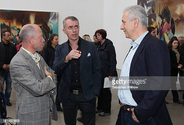 Left to right the 'EigenArt' gallery owner Gerd Harry Lybke Artist Neo Rauch and the German state Saxony prime minister Stanislaw Tillich during the...