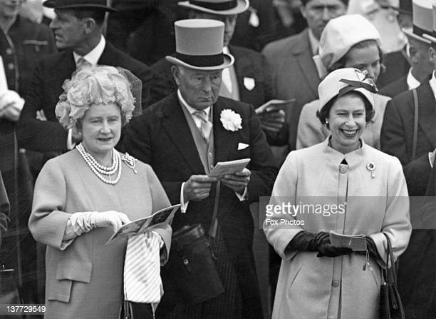 the Queen Mother Bernard FitzalanHoward 16th Duke of Norfolk and Queen Elizabeth II in the Royal enclosure at the Derby Epsom Downs Racecourse Surrey...