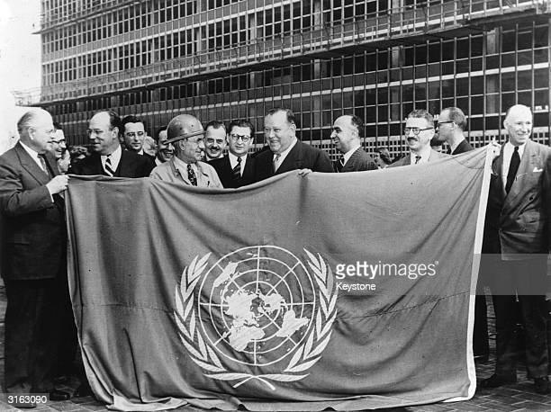 Left to right Warren Austin Lou Chandell President of the Fuller Construction Company Dick Streeter Supt American Bridge Company Trygve Lie the UN...