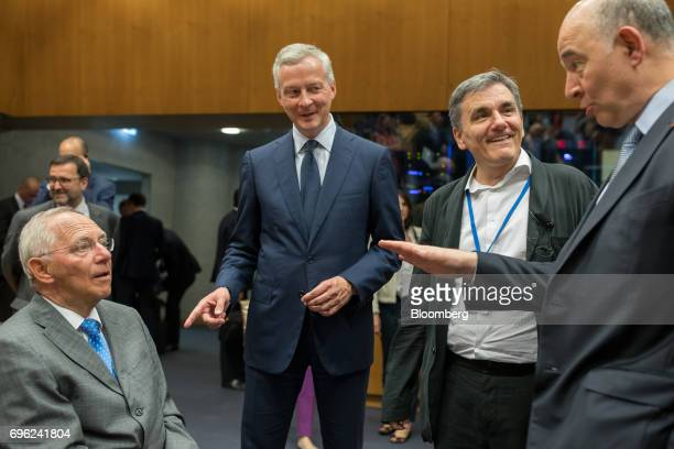Left to right Wolfgang Schaeuble Germany's finance minister Bruno Le Maire France's finance minister Euclid Tsakalotos Greece's finance minister and...