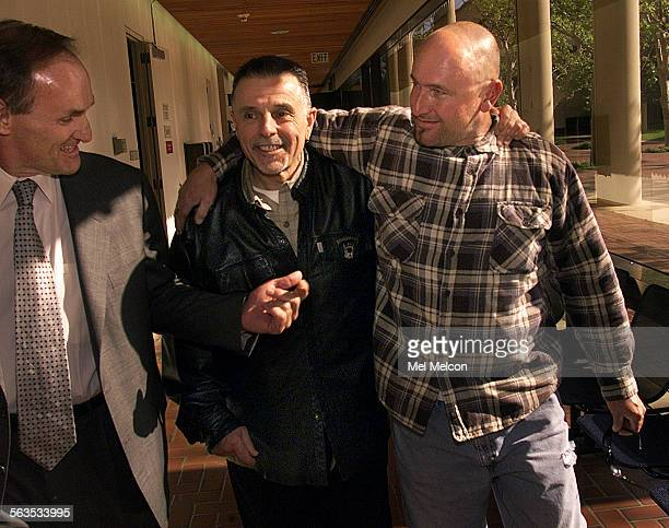 left to right–Attorney Robert Sheahen his client George Christie Jr Pres of the Hells Angels Ventura Chapter walking arm in arm with Vice President...