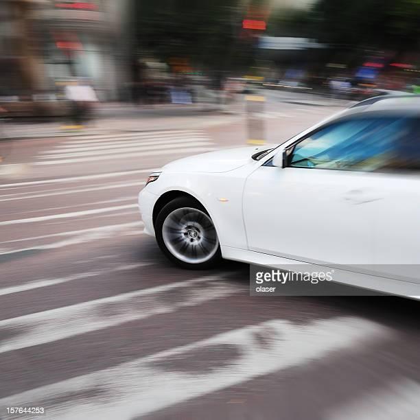 Left turning car on zebra crossing
