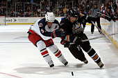 Left wing Alexander Ovechkin of the Washington Capitals skates with the puck against defenseman Adam Foote of the Columbus Blue Jackets on October 5...