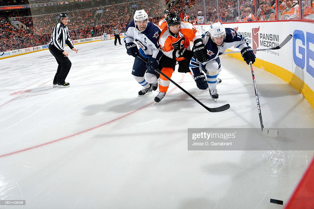 Left Wing <a gi-track='captionPersonalityLinkClicked' href=/galleries/search?phrase=Andrew+Ladd&family=editorial&specificpeople=228452 ng-click='$event.stopPropagation()'>Andrew Ladd</a> #16 ( L) and Center <a gi-track='captionPersonalityLinkClicked' href=/galleries/search?phrase=Bryan+Little&family=editorial&specificpeople=540533 ng-click='$event.stopPropagation()'>Bryan Little</a> #18 ( R) of the Winnipeg Jets chase the puck against <a gi-track='captionPersonalityLinkClicked' href=/galleries/search?phrase=Kimmo+Timonen&family=editorial&specificpeople=201521 ng-click='$event.stopPropagation()'>Kimmo Timonen</a> #44 (C) of the Philadelphia Flyers on February 23, 2013 at the Wells Fargo Center in Philadelphia, Pennsylvania.
