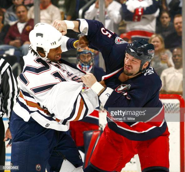 Left Wing Jody Shelley of the Columbus Blue Jackets lands a right hook to Right Wing Georges Laraque of the Edmonton Oilers at Nationwide Arena on...