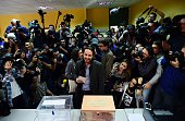 Left wing party Podemos leader and candidate for the election Pablo Iglesias waits to cast his vote at a polling station in Madrid on December 20...