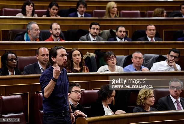 Left wing party Podemos' leader Pablo Iglesias gestures as he takes his seat as lawmaker during the constitution of the Congress at the Palacio de...
