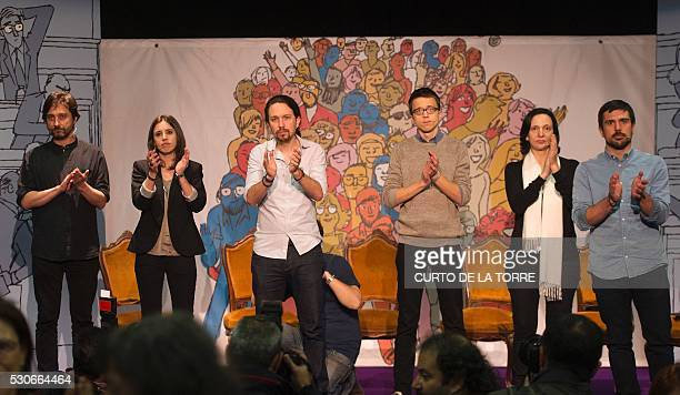 Left wing party Podemos members Rafael Mayoral Irene Montero leader Pablo Iglesias Inigo Errejon Carolina Bescansa and Ramon Espinar applaud during...