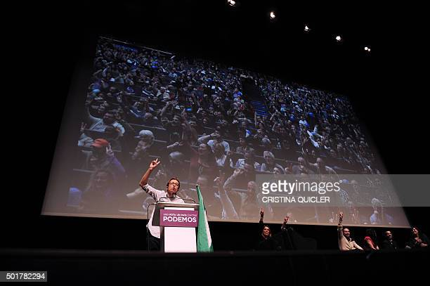 Left wing party Podemos' number three on the Madrid list Inigo Errejon signals a 'V' for victory during a campaign meeting at FIBES Conference and...