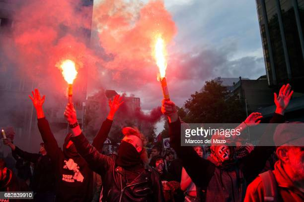 Left wing protesters with flares during a demonstration against far right group 'Hogar Social' and their new occupied building