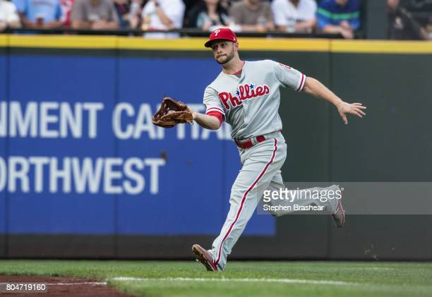 Leftfielder Daniel Nava of the Philadelphia Phillies fields a fly ball during an interleague game against the Seattle Mariners at Safeco Field on...