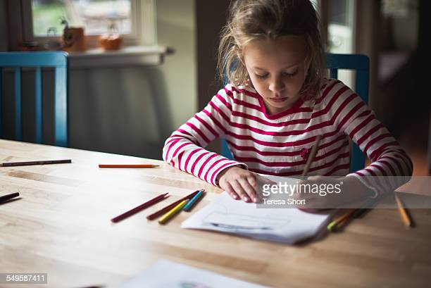 Left-handed Girl Doing Homework