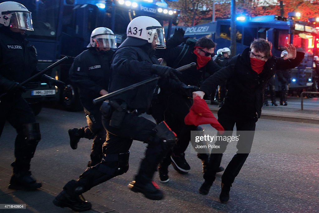 Leftist activists clash with riot police during annual May Day demonstrations on May 1 2015 in Hamburg Germany In Germany May Day traditionally...