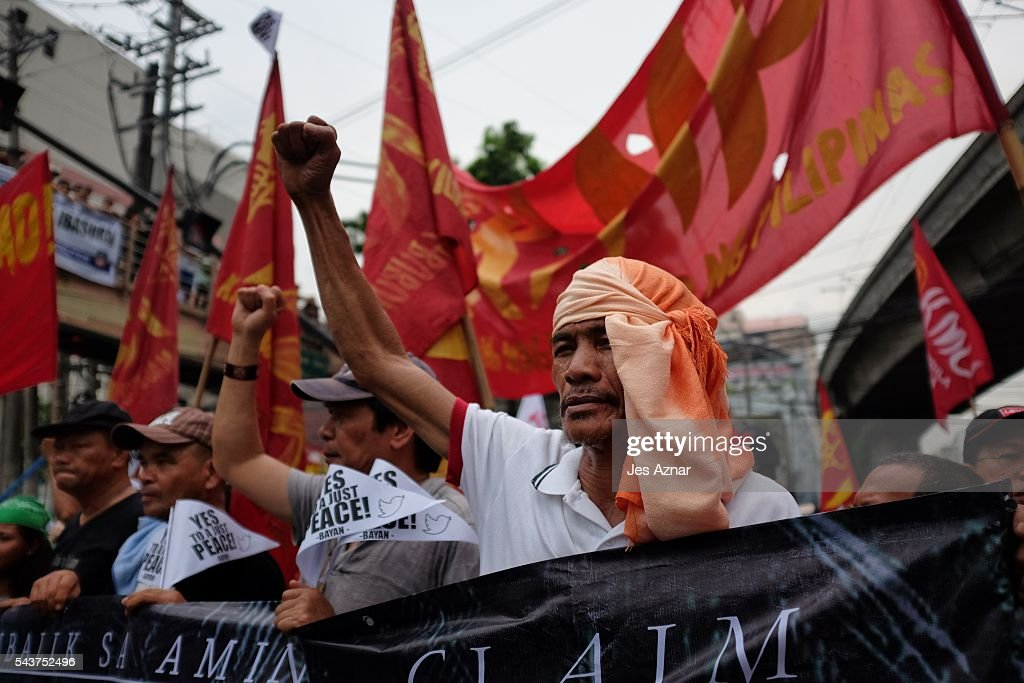 Leftist activists march in Manila to show support for Rodrigo Duterte during his oath to office on June 30, 2016 in Manila, Philippines. Rodrigo Duterte, a city mayor also known as 'The Punisher', was sworn in as the 16th President of the Philippines on Thursday to serve a six-year term while promising to get rid of crime and corruption.