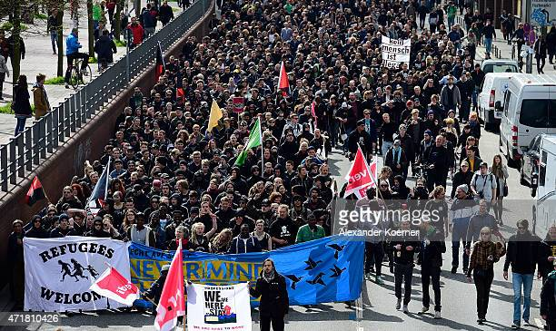 Leftist activists walk in the streets of St Pauli during annual May Day demonstrations on May 1 2015 in Hamburg Germany In Germany May Day...